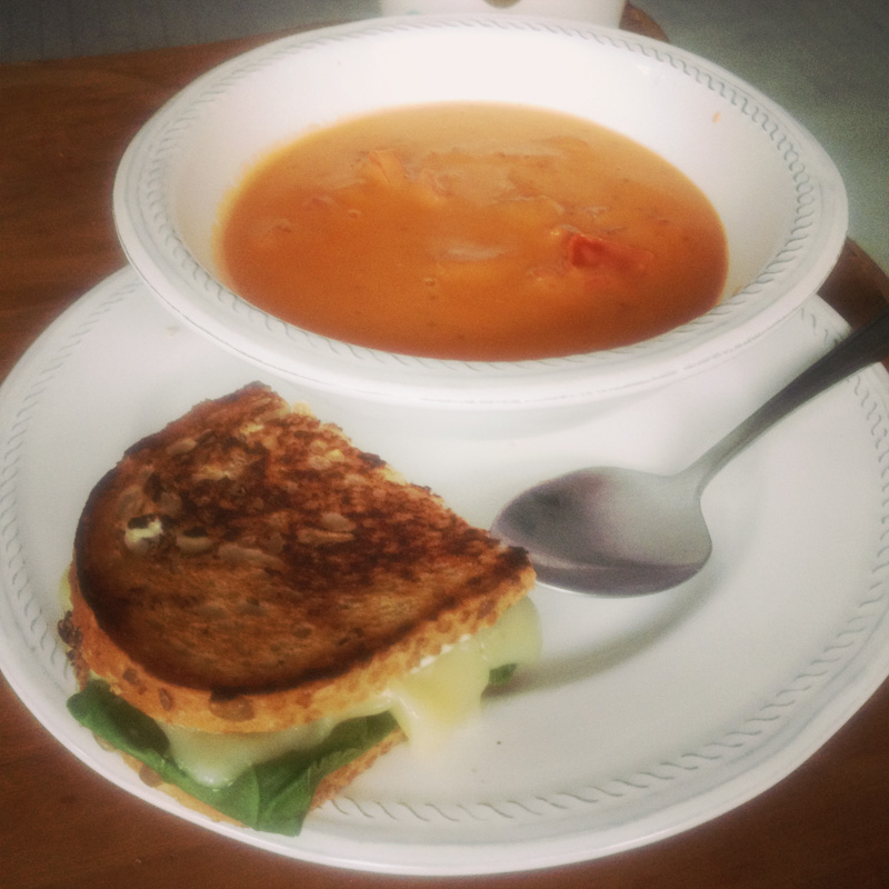 Fresh tomato soup with a side of spinach kale grilled cheese multigrain sadwich